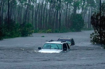 Submerged car sit submerged in water from Hurricane Dorian in Freeport, Bahamas, Tuesday, Sept. 3, 2019. Dorian is beginning to inch northwestward after being stationary over the Bahamas, where its relentless winds have caused catastrophic damage and flooding.(AP Photo/Ramon Espinosa)